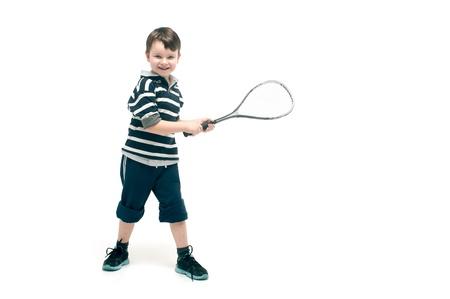 Little boy with tennis racket Stock Photo