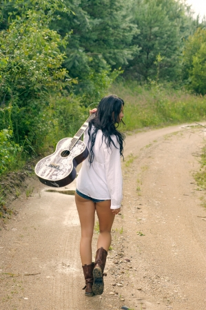 nude ass: Sexy girl with guitar, standing on a countryside road