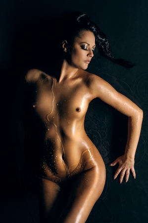 naked girl. water running by her body
