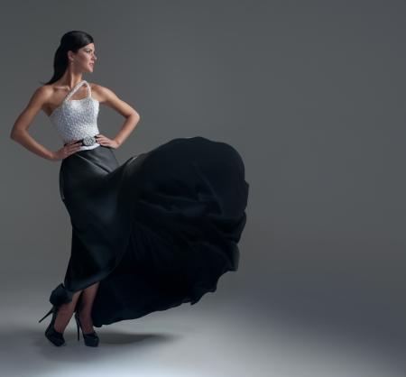 girl dances in a black silk skirt Stock Photo