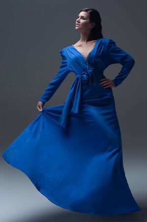 girl in a blue evening dress photo
