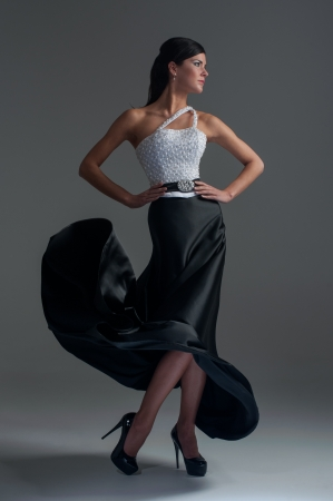 girl dances in a black silk skirt photo