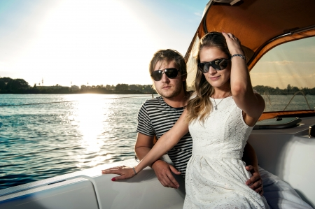 Happy young couple relaxing on a yacht Stock Photo