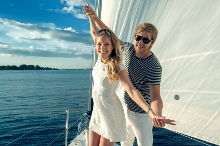 catamaran: Happy young couple relaxing on a yacht Stock Photo