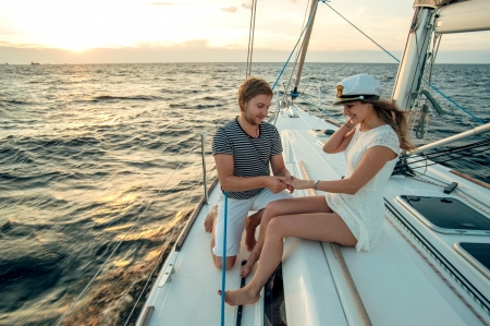 Romantic proposal scene on yacht