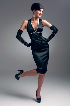 beautiful brunette in a black dress photo