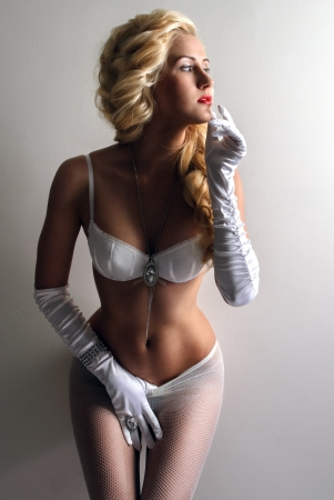 Stylish blonde posing in underwear and stockings