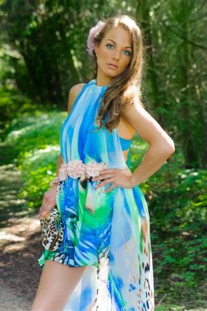 windblown: girl in a silk dress