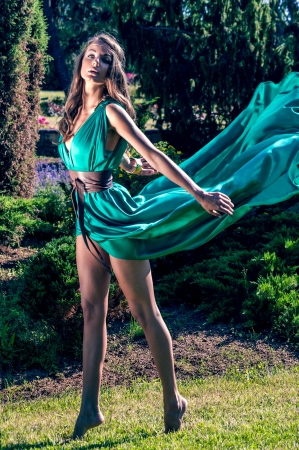 dress blowing in the wind: girl in a silk dress