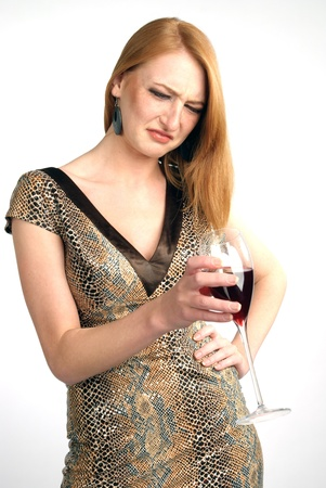 beautiful girl frowns on alcohol photo