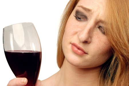 frowns: beautiful girl frowns on alcohol Stock Photo