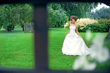 beautiful bride walk through the fabulous park photo