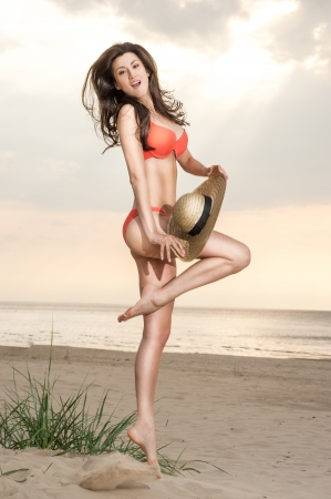 girl in a bathing suit jumping photo