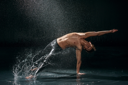 Male dancer under rain photo