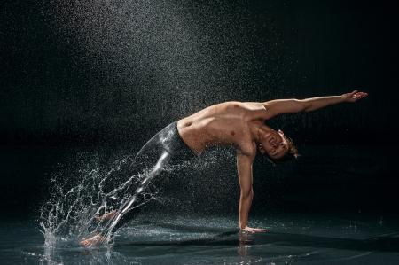 Male dancer under rain