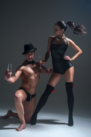 Sexual game  Man and woman drink champagne