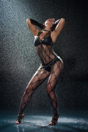 Wet woman in underwear dancing in a studio Stock Photo