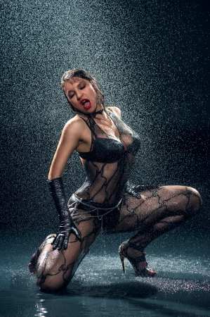 Wet woman in underwear dancing in a studio Stock Photo