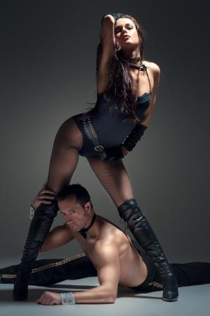 erotic couple: Image of young couple flirting in studio Stock Photo