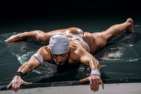 Man in underwear dancing in studio photo