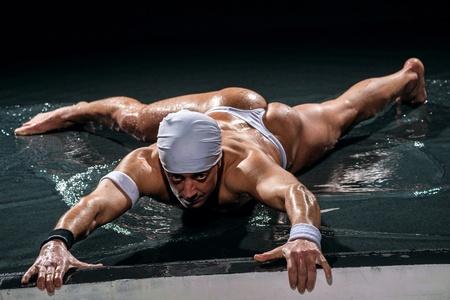 male dancer: Man in underwear dancing in studio