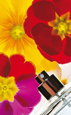 allurement: flovers on background with a spray of parfume