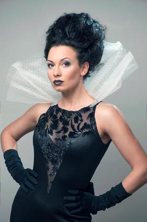 Young elegant queen in black dress Stock Photo - 24260806