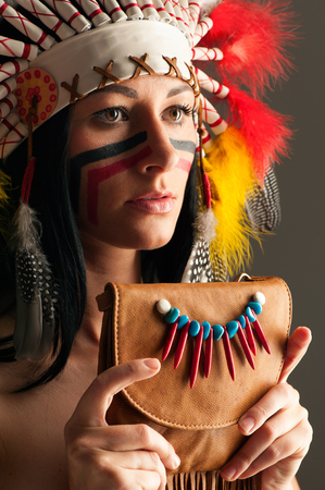 American Indian girl with bag photo
