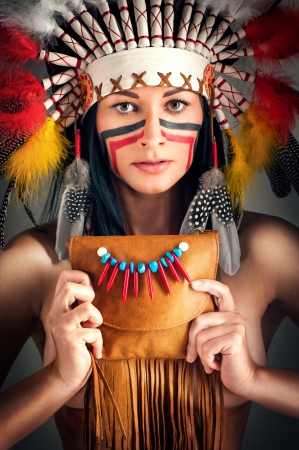 aboriginal woman: American Indian girl with bag