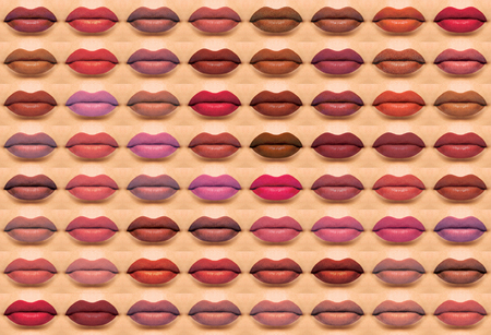 applying lipstick: Hole wall of thw colored lips alot of lips
