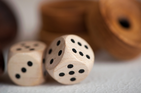 wooden Dice on a soft background color Stock Photo