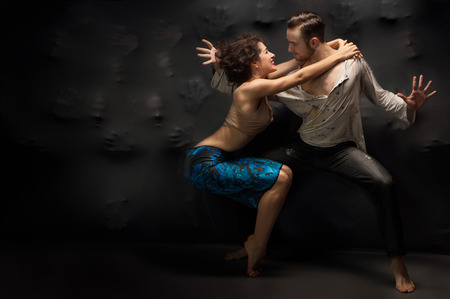 Young couple dancing contemporary. Studio photo