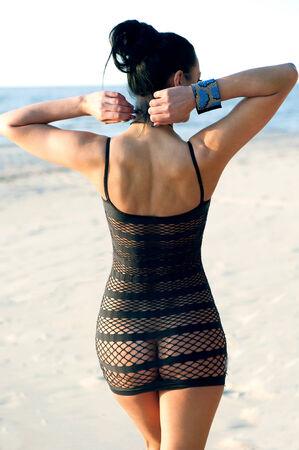 Beautiful brunette in a mesh dress photo