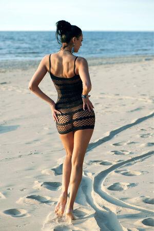 Beautiful brunette in a mesh dress