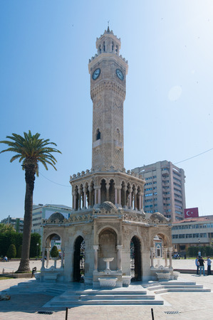 Historical clock tower and palm trees in Konak Square in the city of Izmir, Turkey Editorial