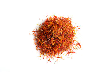 intense flavor: Saffron on white background Stock Photo