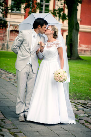 Bride and groom having romantic moment on wedding day photo