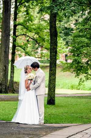 outdoor event: Bride and groom having romantic moment on wedding day