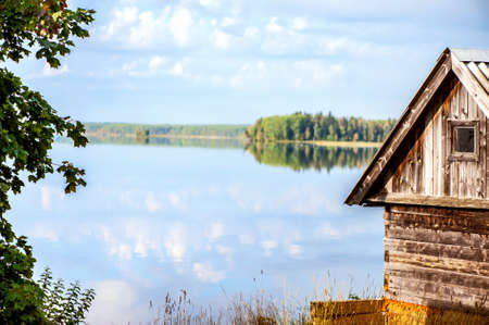 gauja: Wooden country house on lake shore
