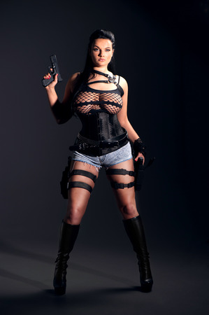 croft: Girl with two guns Stock Photo