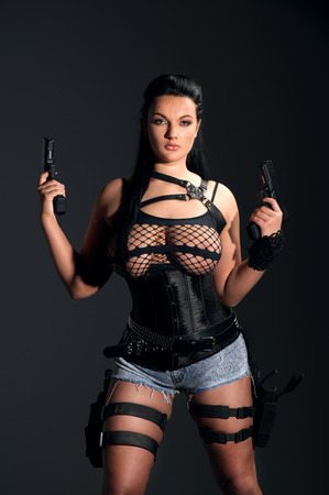 Girl with two guns Stock Photo