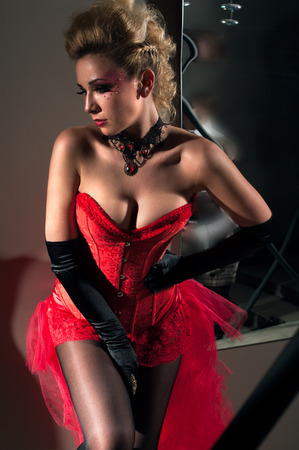 bodice: Attractive woman wearing sexy red corset with a skirt Stock Photo