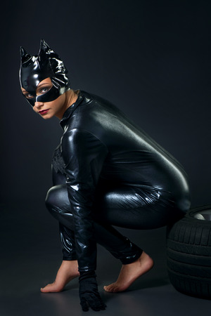Sexy female in black catwoman costume photo