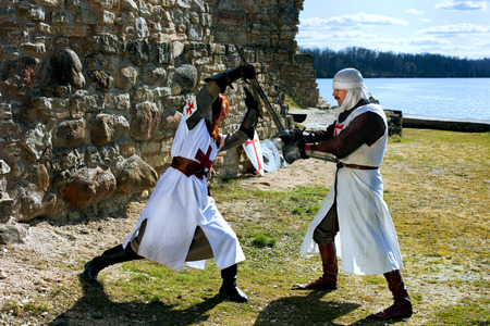 woman with sword: Ancient mystic knights battle