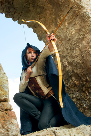 elves: Ancient female archer with bow and arrow Stock Photo