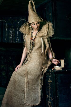middleages: Ancient Medieval woman in costume from gunny sacking