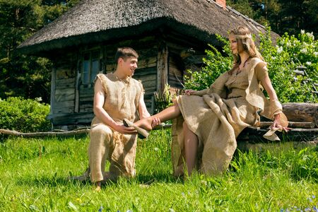 gunny: Ancient Medieval couple in original costumes from gunny sacking