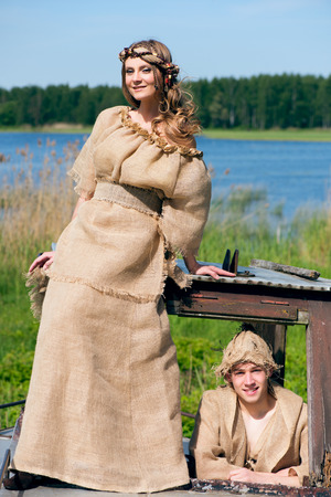 middleages: Ancient Medieval couple in original costumes from gunny sacking