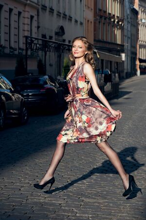 woman nude standing: Beautiful woman in floral dress outdoor