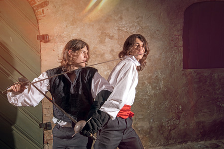 rowdy: Men fighting with swords at old town street
